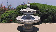 Garden water fountain with two tiers looks dramatic